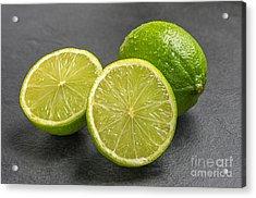 Limes On A Slate Plate Acrylic Print by Palatia Photo