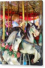 Little Boy On Carousel Acrylic Print by Susan Savad