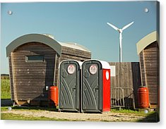 Log Cabins And A Wind Turbine Acrylic Print by Ashley Cooper