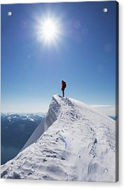 Lone Climber On The Top Of A  Mountain Acrylic Print by Buena Vista Images
