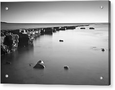 Long Exposure Image Of Tide Going Out Over Rock Ledge During Sun Acrylic Print by Matthew Gibson