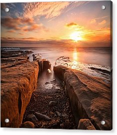 Long Exposure Sunset At A Rocky Reef In Acrylic Print by Larry Marshall