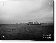 looking across Vancouver harbour to vancouver downtown skyline on dull grey rainy day BC Canada Acrylic Print by Joe Fox