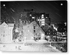 looking out atTromso bryggen quay harbour on a cold snowy winter night troms Norway europe Acrylic Print by Joe Fox