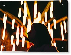 Low Angle View Of Silhouette Woman Against Illuminated Lights At Night Acrylic Print by Adriana Duduleanu / EyeEm