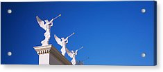 Low Angle View Of Statues On A Wall Acrylic Print