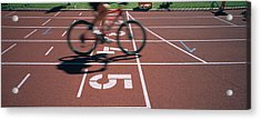 Low Section View Of A Man Cycling Acrylic Print by Panoramic Images