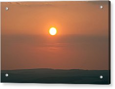 Low Setting Sun Over Distant Landscape Acrylic Print by Matthew Gibson