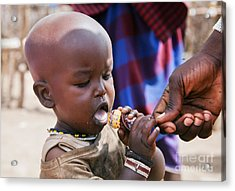 Maasai Child Trying To Eat A Lollipop In Tanzania Acrylic Print by Michal Bednarek
