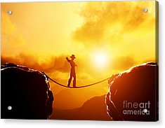 Man In Hat Walking On Rope Over Mountains Acrylic Print by Michal Bednarek