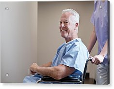Man In Hospital Gown In Wheelchair Acrylic Print by Science Photo Library