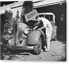 Man Working On His Car Acrylic Print by Underwood Archives