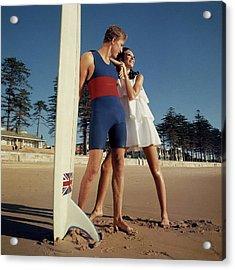 Marisa Berenson And Nat Young On A Beach Acrylic Print