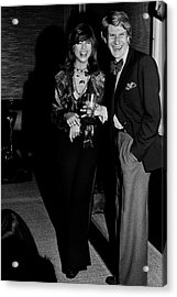 Mary Russell Laughing With Yves St. Laurent Acrylic Print by Henry Clarke