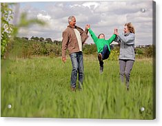 Mature Couple Swinging Grandchild In Acrylic Print by Bloom Productions