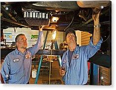Mechanics Repairing Recreational Vehicle Acrylic Print by Jim West
