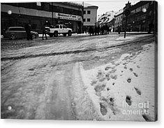 melting ice and snow on street surface holmen Honningsvag finnmark norway europe Acrylic Print by Joe Fox