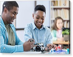Mentor And Male Student Working Together On A Robot Acrylic Print by Steve Debenport