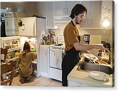 Millennial Couple Of Students Shared Living Doing Chores. Acrylic Print by Martinedoucet