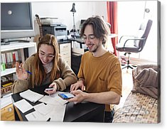Millennial Couple Using Digital Payment To Share Expense. Acrylic Print by Martinedoucet