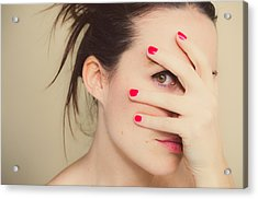 Misterious Girl With Red Nails And Hand On Face. Acrylic Print by Volanthevist