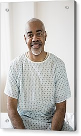 Mixed Race Older Man Sitting On Hospital Bed Acrylic Print by JGI/Jamie Grill