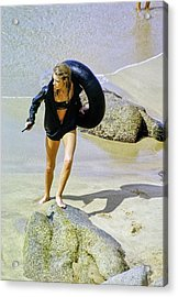 Model Carrying An Inflatable Tube And Gun Acrylic Print