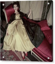 Model Reclining In An Evening Dress And Coat Acrylic Print