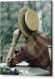 Model Sitting At A Table Wearing A Boater Hat Acrylic Print