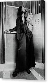 Model Wearing A Larry Aldrich Pantsuit Holding Acrylic Print by Kourken Pakchanian