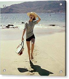 Model Wearing A Straw Hat On A Beach Acrylic Print
