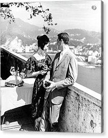 Models Holding Wine On A Balcony Acrylic Print by Richard Waite