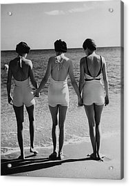 Models On A Beach Acrylic Print by Toni Frissell