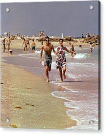 Models Running On A Beach Acrylic Print