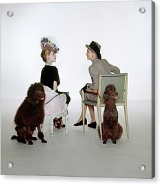 Models Sitting With Poodles Acrylic Print by John Rawlings