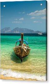 Moored Longboat Acrylic Print by Adrian Evans