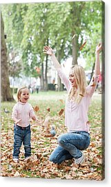 Mother And Daughter Playing With Leaves Acrylic Print