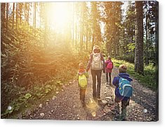 Mother And Kids Hiking In Sunny Forest Acrylic Print by Imgorthand