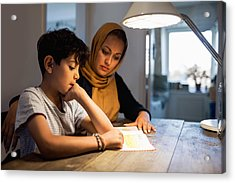Mother And Son Reading Book Under Illuminated Desk Lamp At Home Acrylic Print by Maskot