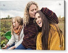 Mother Kissing Teenage Daughter Strolling In Trailer In Field. Acrylic Print by Martinedoucet