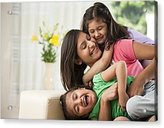 Mother With Daughters (6-7) Sitting On Sofa Acrylic Print by ImagesBazaar