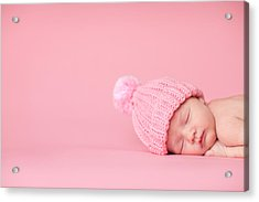 Newborn Baby Girl Sleeping Peacefully On Pink Background Acrylic Print by Ideabug