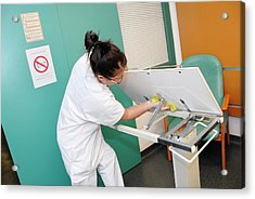 Nurse Cleaning Hospital Table Acrylic Print by Aj Photo/science Photo Library
