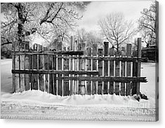 old patched up wooden fence using old bits of wood in snow Forget Saskatchewan  Acrylic Print by Joe Fox