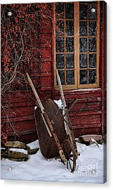 Old Wheelbarrow Leaning Against Barn In Winter Acrylic Print