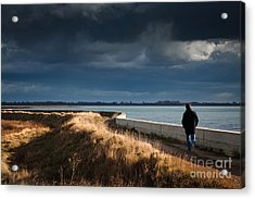 One Man Walking Alone By Sea Wall In Sunshine On Dramatic Stormy Acrylic Print