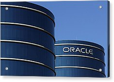 Oracle Makes Hostile Bid For Rival Peoplesoft Acrylic Print by Justin Sullivan