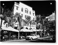 Orange Chevrolet Bel Air In The Cuban Style Outside The Edison Hotel Acrylic Print by Joe Fox