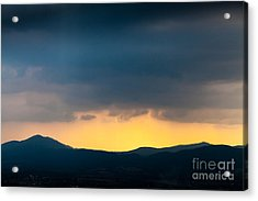 Overcast Dark Sky Rain Clouds With Yellow Glow Beyond Hills On H Acrylic Print