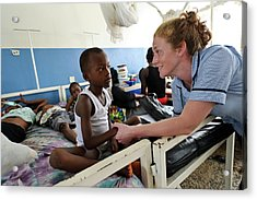 Paediatric Nursing In Sierra Leone Acrylic Print by Matthew Oldfield